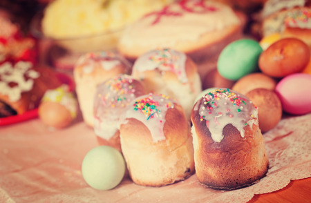 Easter cakes and eggs on festive table Stock Photo