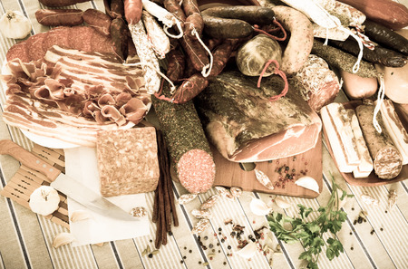 carne picada: Variety of meats, sausages and mince with herbs on table