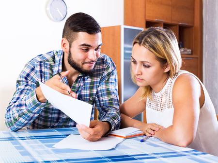 middle joint: Portrait of young woman and her smiling husband with papers Stock Photo