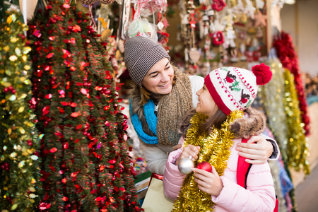 overspending: Laughing mother and small daughter in Christmas market Stock Photo