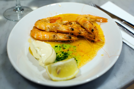 ready to eat served in the restaurant cooked prawns with souse Stock Photo