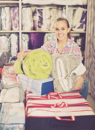 boasting: Girl customer enjoying her various purchases in textile shop