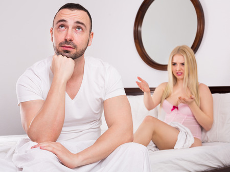 Unsatisfied wife and sad young husband having big difficulties in the bed
