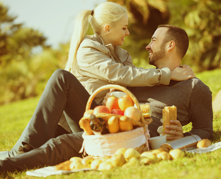 Portrait of young adults with apples and sandwitches in nature together