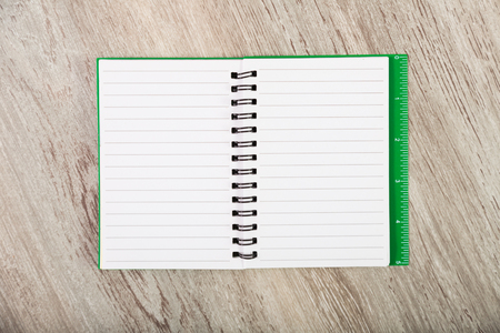 not open: Open notebook with pages in line on table