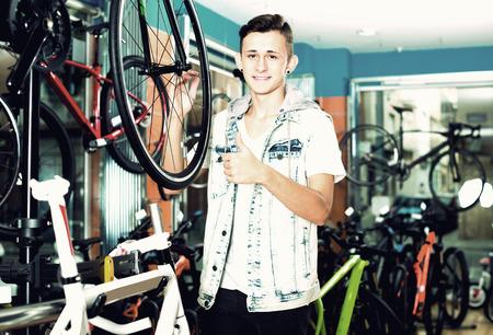 Adult teenage boy looking for new sport bike in store