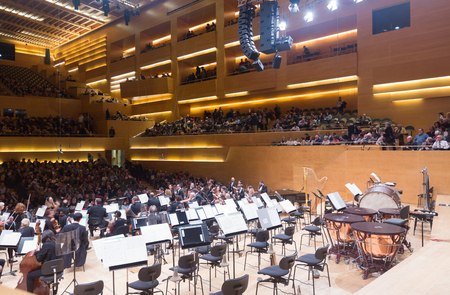 romeo and juliet: BARCELONA, SPAIN - NOVEMBER 28, 2015: Music hall Auditori.  Audience and orchestra municipal de Barcelona at the concert Romeo and Juliet by Prokofiev Editorial
