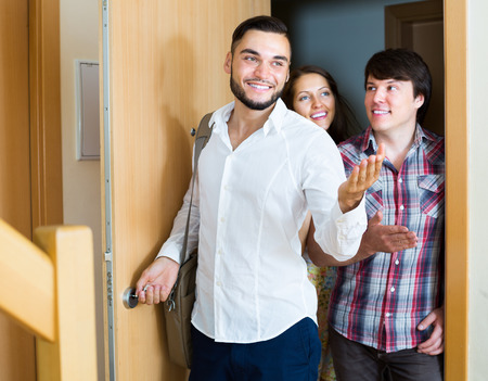 accommodation broker: Realtor showing a new flat to happy couple