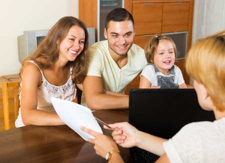 hypothec: Parents with daughter glad hearing words of social worker at  home