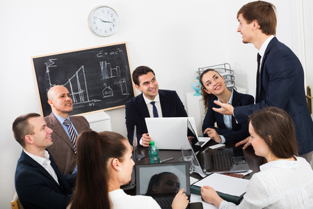 Chief with professional officials discussing preparing a important contract Stock Photo