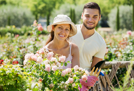Young smiling family gardening together Stock Photo