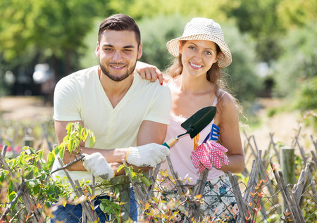Happy family is engaged in gardening together