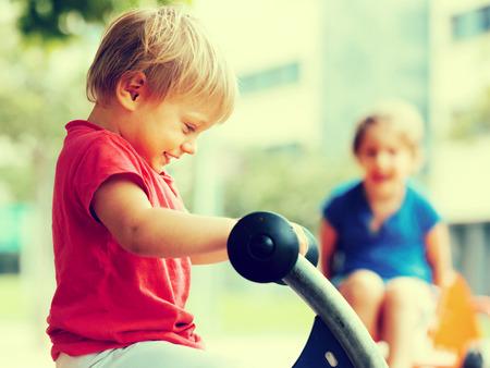5s: Happy children having fun at playground in sunny day