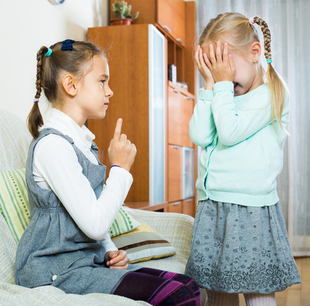 shaming: Annoying big american sister preaching little one and shaking finger