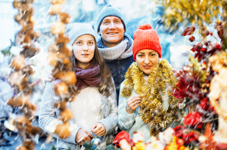 Happy parents with teenage girl at counter of X-mas market Stock Photo