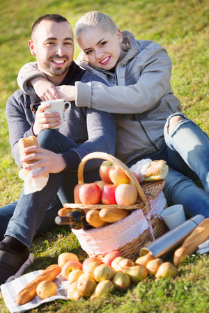sandwitch: Loving pleasant  couple chatting as having picnic in sunny day
