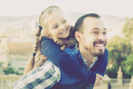 journeying: Smiling father and daughter exploring city during sightseeing tour Stock Photo