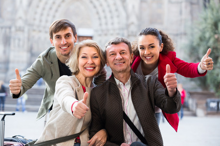 Close up of smiling tourists posing on European city street