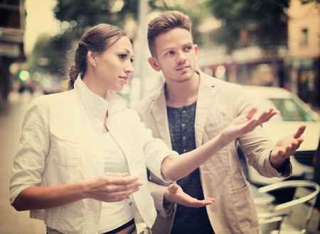 sidewalk talk: Woman showing direction to guy at the street