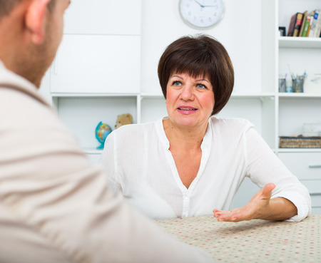 to prefer: Employer discusses with elderly woman term of contract Stock Photo