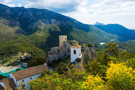 scenic landmark with old Guadalest castle building located on top of mountains