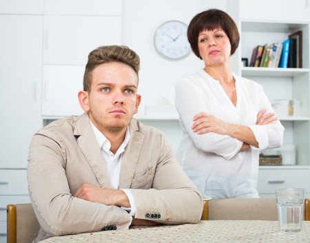 persuade: Son was upset and has turned away from mother who calms him