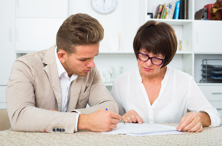 Man consults at the familiar lawyer concerning paperwork Stock Photo