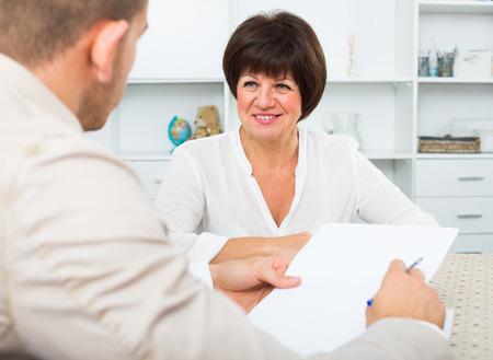 gets: Elderly woman gets job and discusses with employer of term of contract