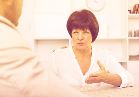 Elderly woman gets job and discusses with employer of term of contract