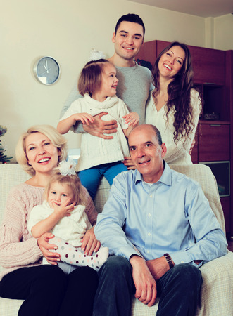 three generations of women: smiling family with grand children Stock Photo
