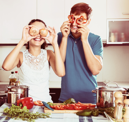 domestic kitchen: Young family couple cooking vegetables in domestic kitchen together Stock Photo