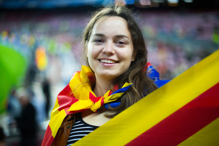 Excited happy adult girl with Catalonia flag rooting for football team Stock Photo
