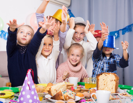 animated boy: Group active children having fun during birthday party