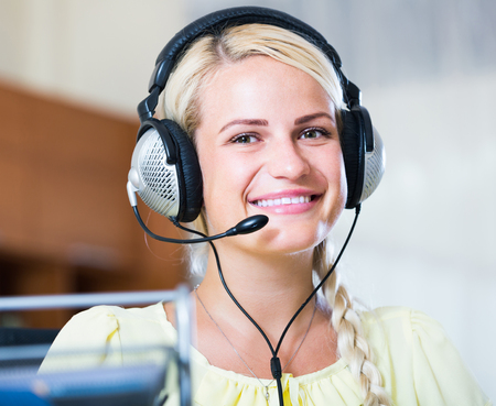 young spanish girl answering the call of technical support and smiling