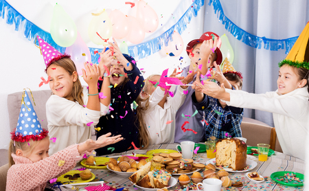 animated boy: Positive group of children having fun during friend�s birthday party Stock Photo
