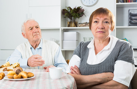 disagreeing: Husband and wife having disagreement with each other at home Stock Photo