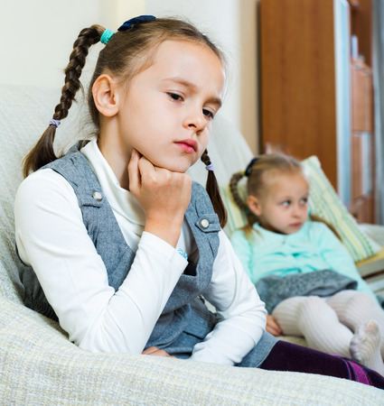 Portrait of two little upset miserable girls having conflict at home Stock Photo