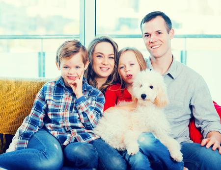 Optimistic family enjoying evening together at home Stock Photo