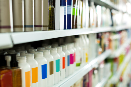 Cosmetic section with conditioners, shampoo and hair treatment in shop