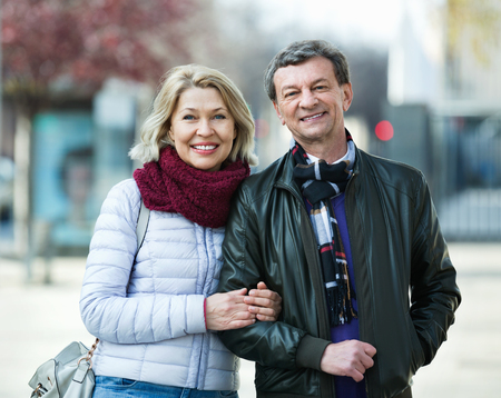 Portrait of happy positive mature couple in city at spring day Stock Photo