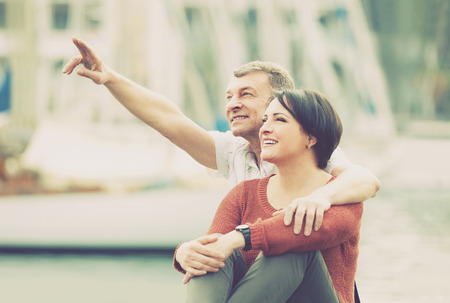 positive american mature couple hugging outdoors at sunny spring day Stock Photo