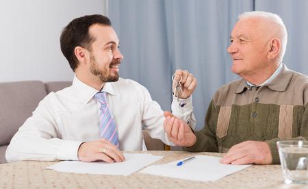 Senior man preparing property papers at home