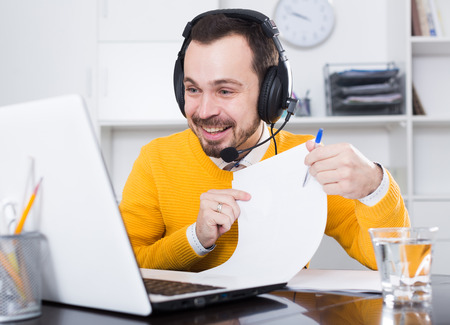 essays: Smiling man learner studying effectively at online courses at home