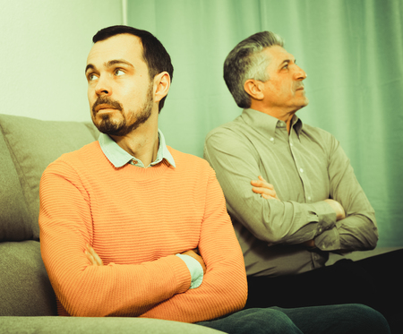 persuade: Adult father and young son discuss and solve family problems