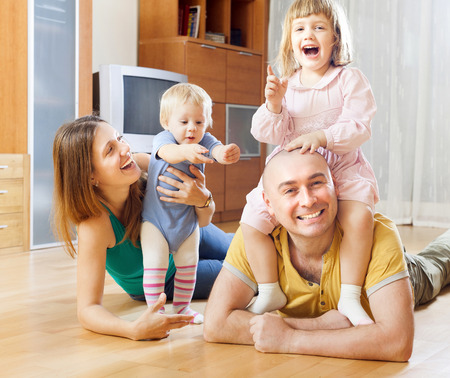 3 4 years: Happy parents with two children at home interior