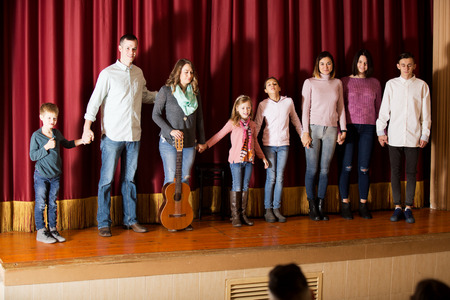 Smiling group of performers came to bow to audience after concert
