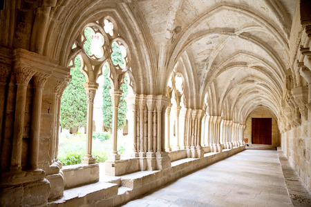 Inner galleries of Poblet Monastery at summer day in Catalonia