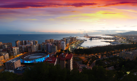 Top  view of seaside part of Malaga with Port from castle in  sunrise time.   Spain Stock Photo