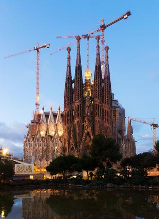 BARCELONA, SPAIN - NOVEMBER 23, 2015: Sagrada Familia in twilight time. Barcelona, Spain.  Famous Church by architect Antoni Gaudi