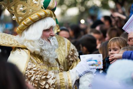 melchor: BARCELONA, SPAIN –  JANUARY 5, 2017: King Melchor with entourage takes letters from children. Barcelona, Spain